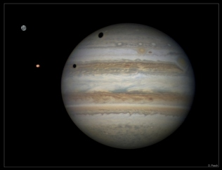 Moon shadows (Ganymede & Io) on Jupiter
