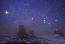 Mars and Orion over Monument Valley