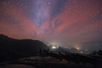 Milky Way and red airglow over rice terrace