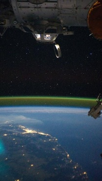 Taking pictures from cupola of the ISS